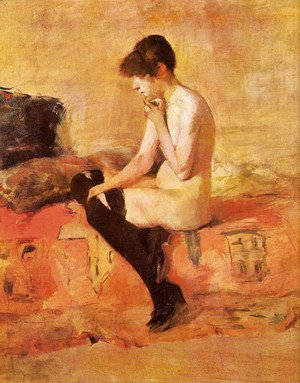 Nude woman on a divan